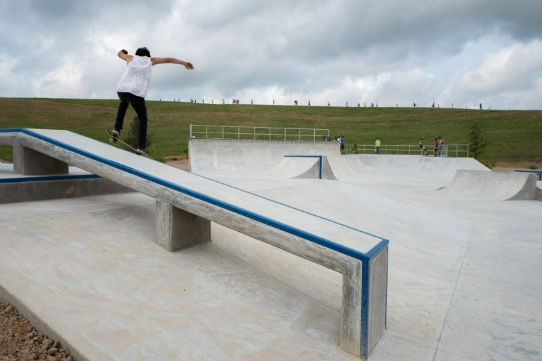 Skateboarders, roller skaters, and rollerbladers take to the newly opened skate park. Photo by Scott Ball.