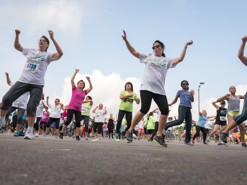 Community members participate in a Zumba session held for the opening of the park. Photo by Scott Ball.
