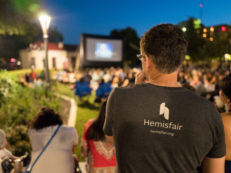 An attendee wears a Hemisfair branded tee-shirt as he watches a presentation. Photo by Scott Ball.
