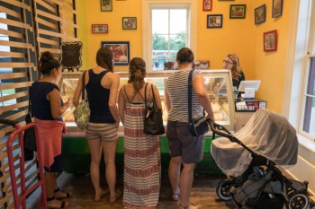 Guests browse paleta options for a dessert during the grand opening of Paleteria San Antonio. Photo by Scott Ball.