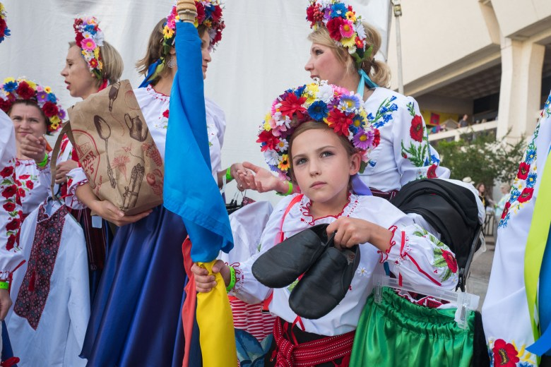 Victoria, 9, holds her dancing shoes before she performs the with Ukrainian dance group 'Vaselka'. Photo by Scott Ball.