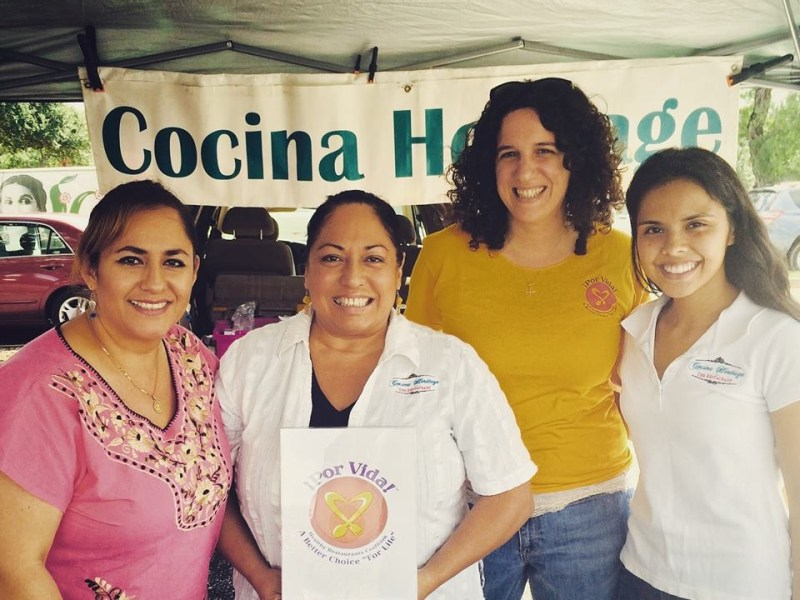 From left: Lupita Rivero and Silvia Alcaraz, sisters and owners of Cocina Heritage; Anna Macnak, Por Vida program dietitian; and Maria, Cocina Heritage staff member at a San Antonio Farmer's Market. Photo courtesy of San Antonio Metropolitan Health District.