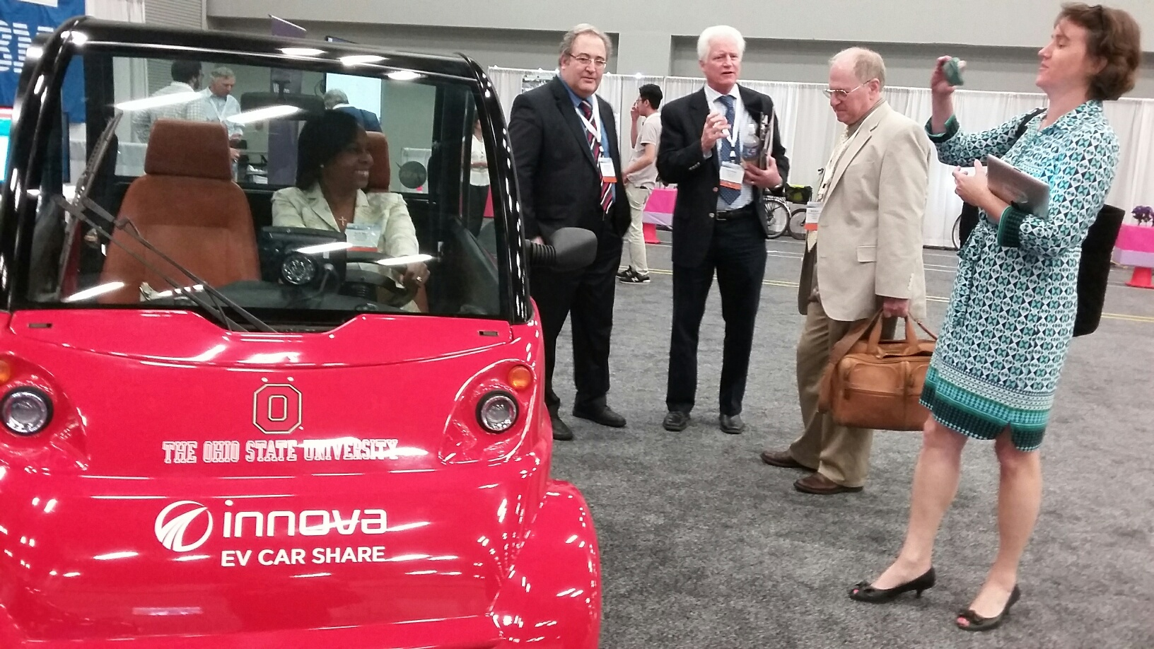 Mayor Ivy Taylor sits in an Innova EV Dash which is used in a carshare program at Ohio State University and four other universities. Photo by Edmond Ortiz.