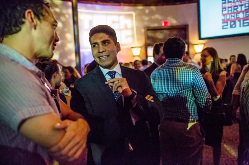 Councilman Rey A. Saldaña (D4) speaks with Nicolas Rivard at TechBloc. Photo by Michael Cirlos.