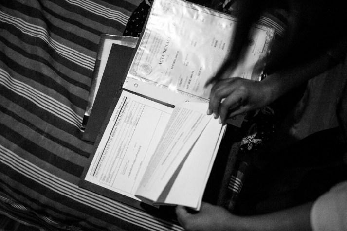 Araceli looks through her paperwork to apply for citizenship. Photo by Kathryn Boyd-Batstone.