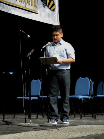 12-year-old Jybr Reynoso Hidrogo comes up to the microphone to enunciate a word. Photo by Rocio Guenther.