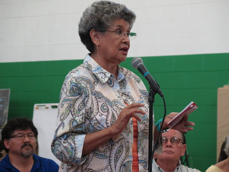 María Berriozábal, 75, a former San Antonio councilwoman, speaks to the audience about her concerns. Photo by Rocio Guenther.