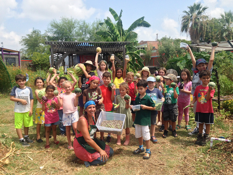 Session two campers pose with the produce they harvested on Tuesday July, 26.