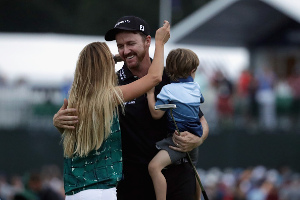 Jimmy Walker of the United States celebrates with his wife Erin (L) and son Beckett (R) after making par on the 18th hole to win the 2016 PGA Championship at Baltusrol Golf Club on July 31, 2016 in Springfield, New Jersey. Photo by Streeter Lecka/Getty Images.