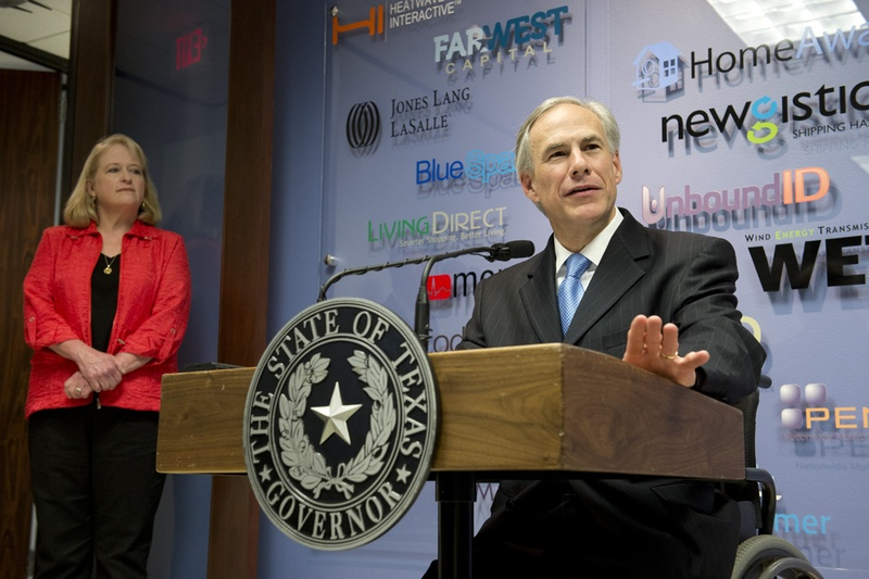 Gov. Greg Abbott holds a press conference with Ellen Wood, president and CEO of vcfo on his plans to greatly reduce the Texas business franchise tax, on April 15, 2015. Photo by Bob Daemmrich for the Texas Tribune.