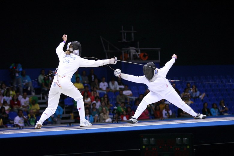 Courtney Hurley (left) lunges towards her opponent, Canadian Julie Leprohon. Courtesy photo.