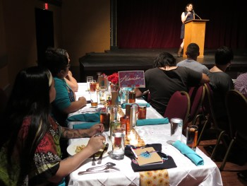Participants in the 2016 Macondo Young Writers' Workshop listen to Laurie Ann Guerrero speak at the Macondo Welcome Dinner.  Photo by Camille Garcia.