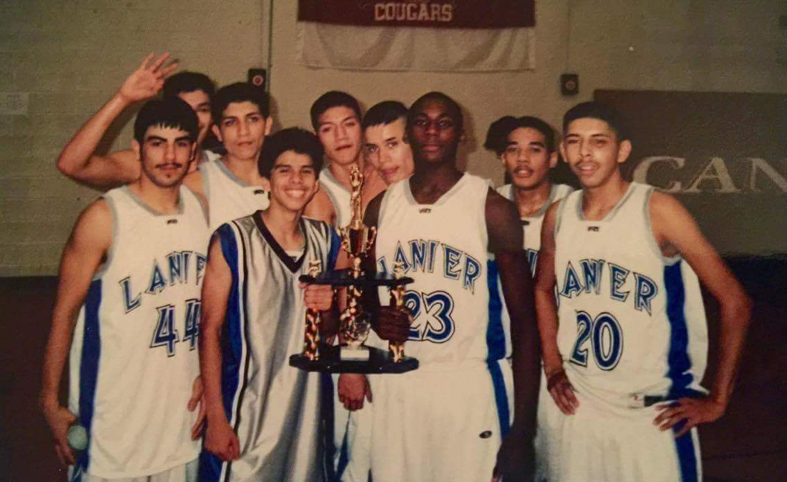 Orlando Mendez-Valdez age 17, third from left, celebrating a tournament victory with Lanier High School teammates in 2003. Photo by Abel Valdez