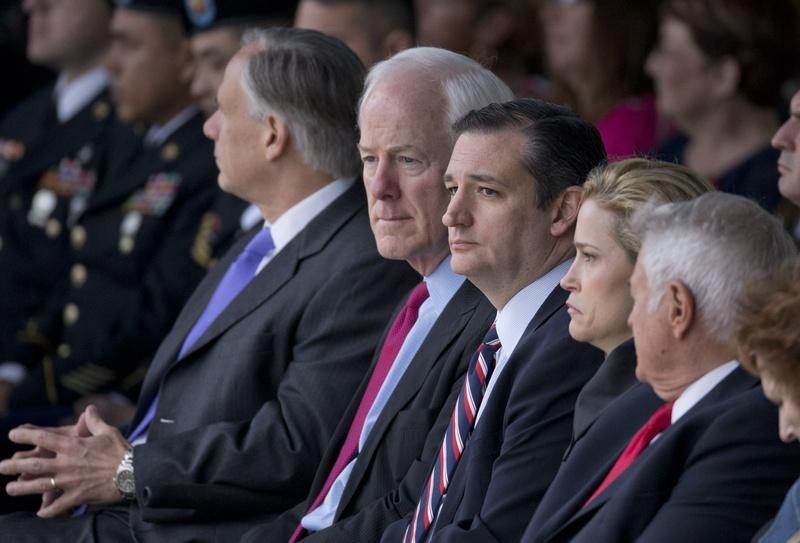 U.S. Sen. John Cornyn sits with U.S. Sen. Ted Cruz and wife Heidi Cruz at the Fort Hood Purple Heart ceremony on April 10, 2015. Photo by Bob Daemmrich.