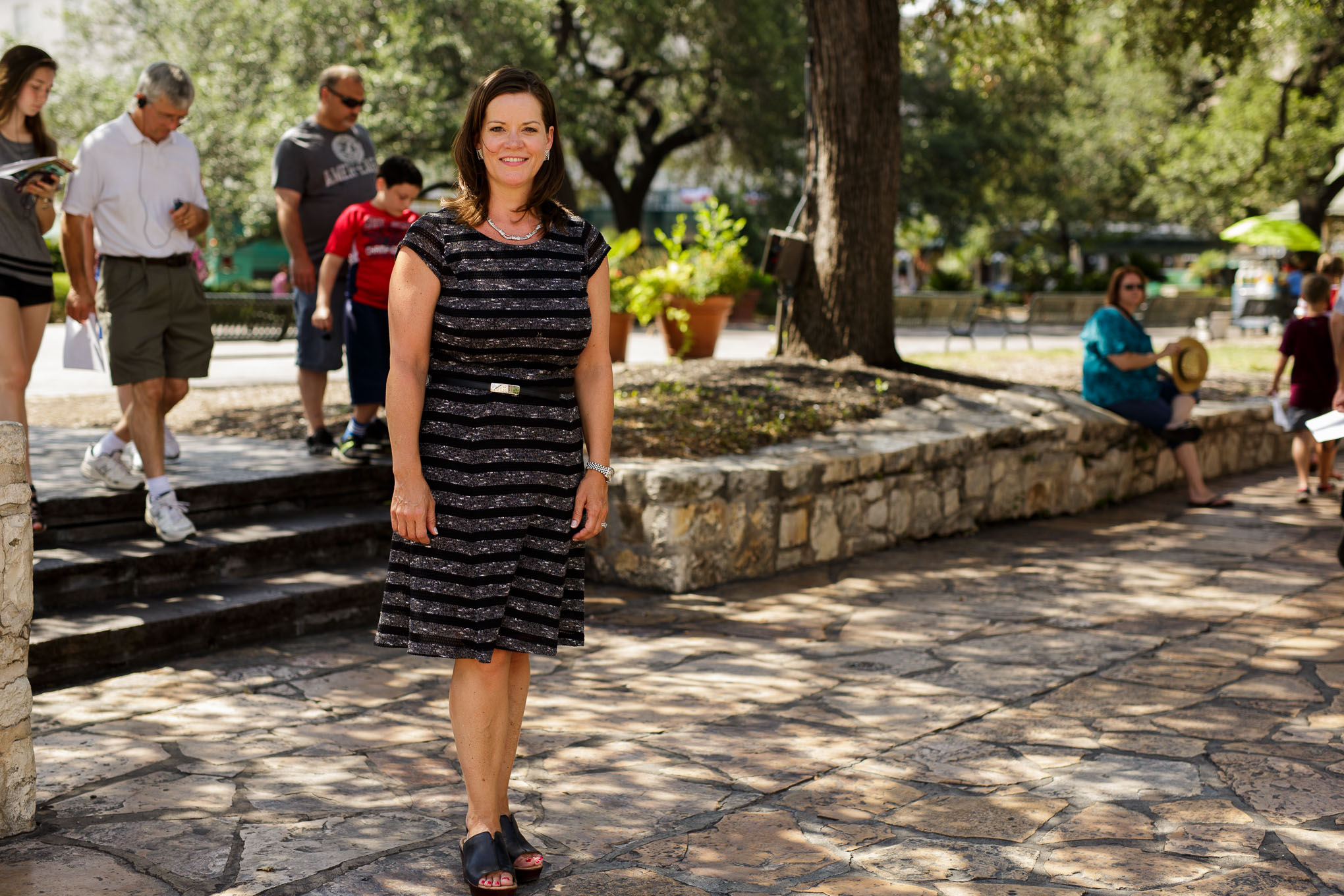 Alamo Director Becky Dinnin stands atop one of the selected archaeology dig sites slated in the next weeks. Photo by Scott Ball.