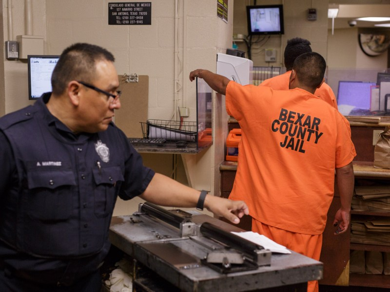 Inmates await intake at the Bexar County Adult Detention Center. Photo by Scott Ball.