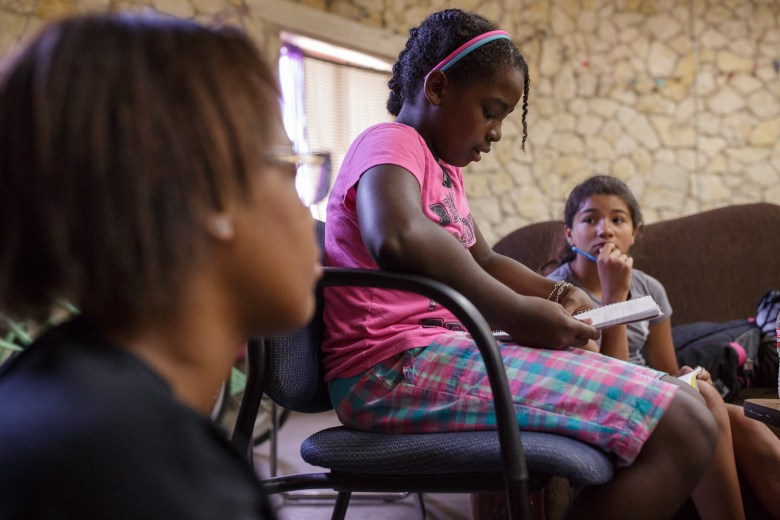 Naomi, 11, shares one of her poems in a small group with other girls. Photo by Scott Ball.