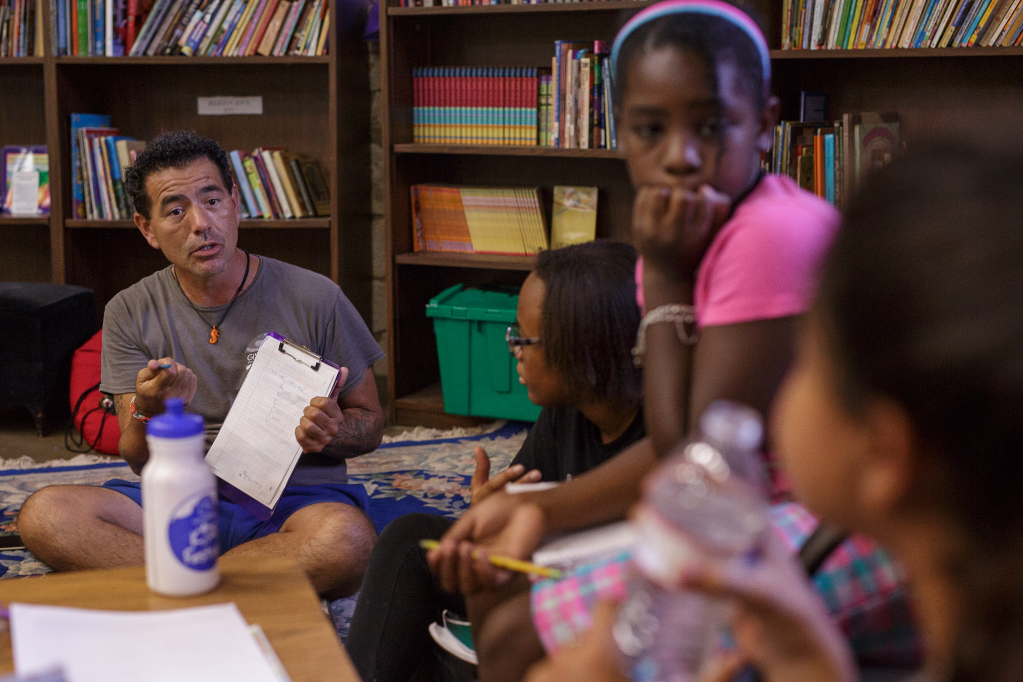 Ernesto Olivo instructs his small breakout group with ideas on creative ways to write poems. Photo by Scott Ball.