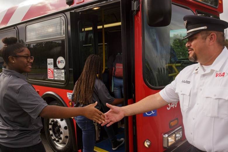 VIA Supervisor Charles Brunn shakes hands with an Eastside Dreamer as he welcomes her aboard. Photo by Scott Ball.