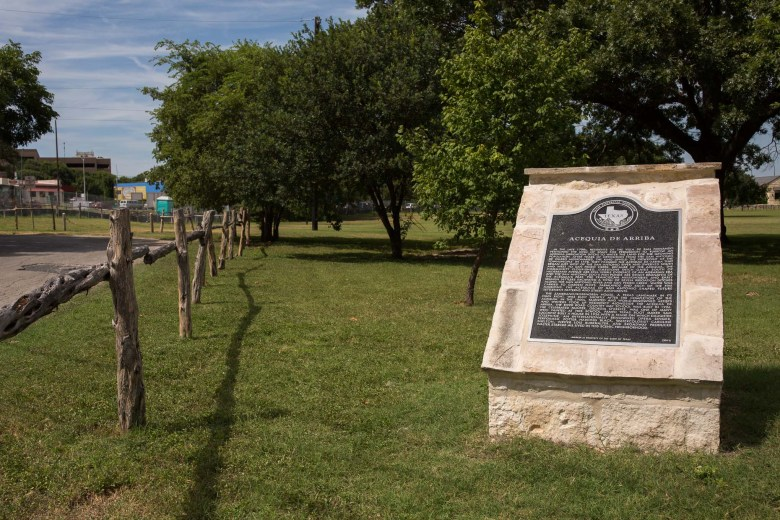 The Texas Historic Commission marker indicating the Acequia De Arriba.  Photo by Scott Ball.