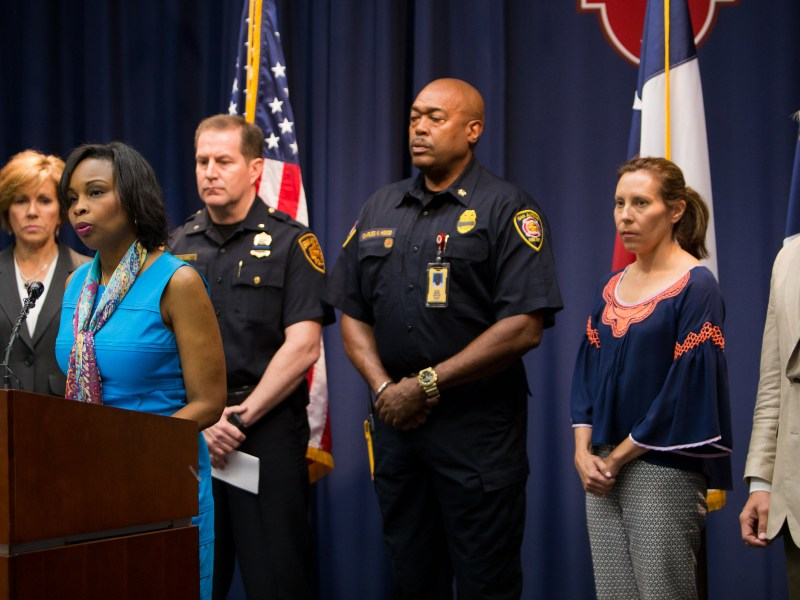 Mayor Ivy Taylor stands with City staff members as she gives a statement in response to the violence that has spread across the nation. Photo by Scott Ball.