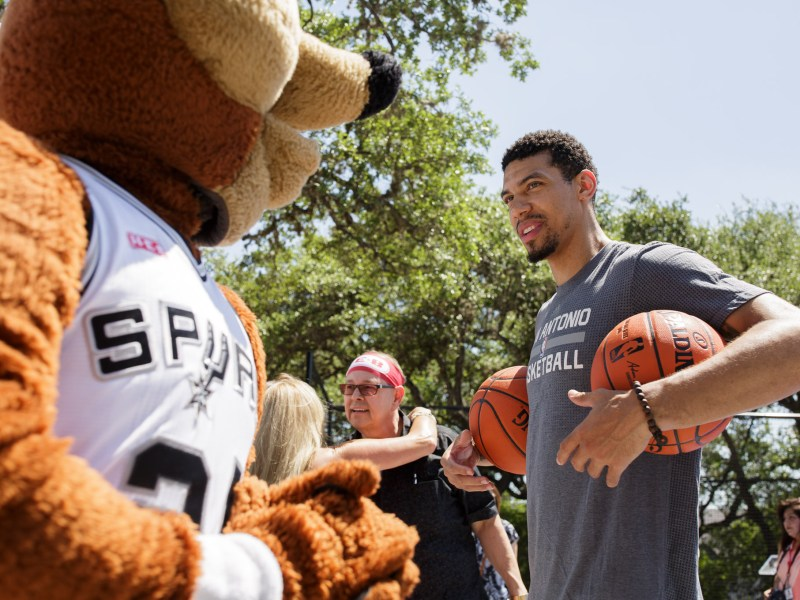 Spurs guard Danny Green interacts with Spurs Coyote on the newly opened court. Photo by Scott Ball.