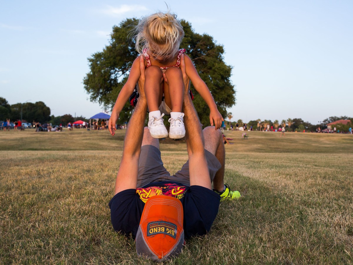 Douglas Phelps holds his daughter Finnley, 3, in the air as he rocks her back and forth and side to side. Photo by Scott Ball.