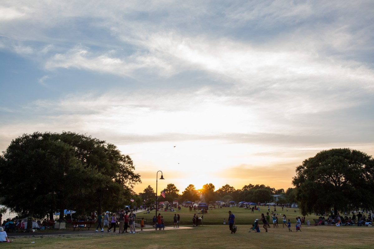 The Woodlawn Lake fields were flooded with families playing football, cooking, and enjoying the views. Photo by Scott Ball.