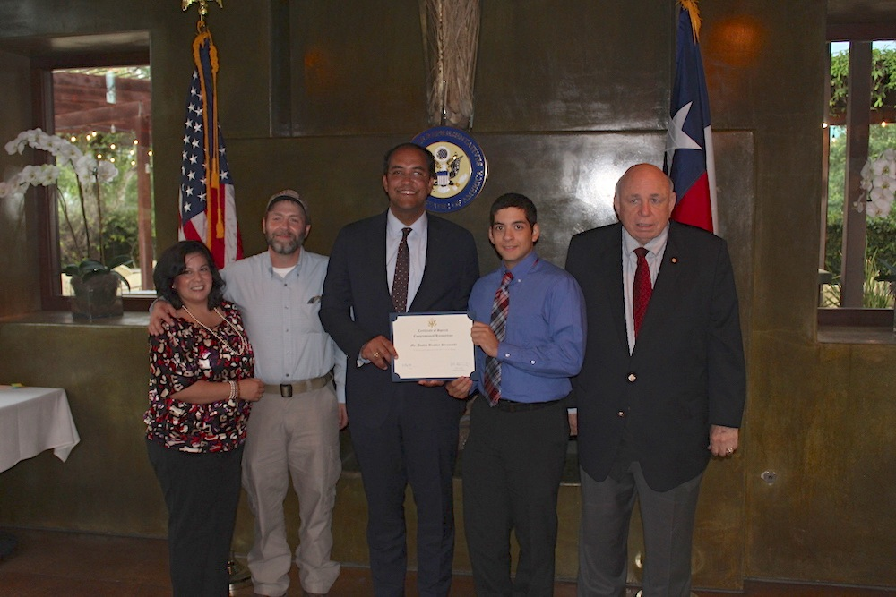 Austin Stromoski (second from right) honored by Rep. Will Hurd (center). Courtesy photo.