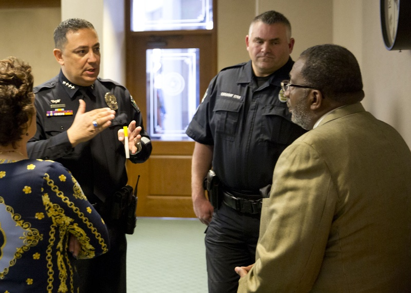 Austin Police Chief Art Acevedo and Austin Police Association President Kenneth Casaday speak with state Sen. Royce West, D-Dallas, right, on Feb. 12, 2015, at the Texas Capitol. Photo by Marjorie Kamys Cotera