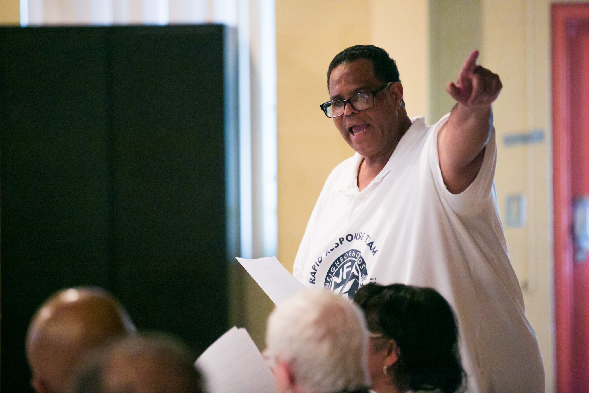 Neighborhoods First Alliance President Tommy TC Calvert speaks about the need for a $777,000.00 crime prevention budget. Photo by Kathryn Boyd-Batstone.