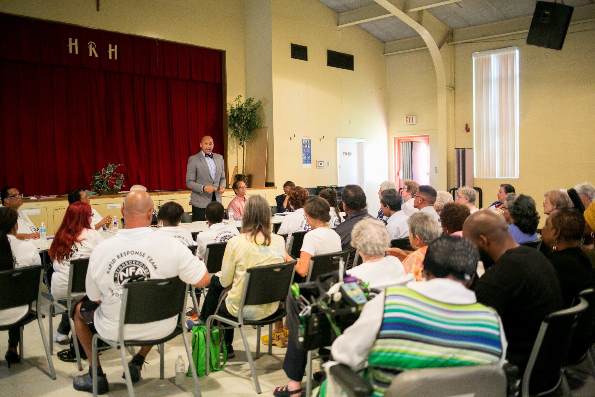 City Councilman Alan Warrick (D2) speaks with Neighborhoods First Alliance (NFA), Community Organized for Public Service (COPS), Metro Alliance, and Sisters of the Holy Spirit Convent about his efforts for an increased minimum wage and less crime. Photo by Kathryn Boyd-Batstone.