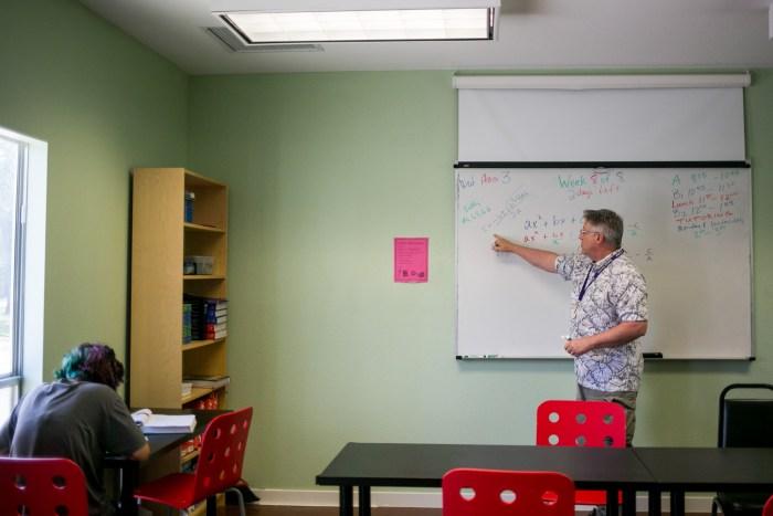 A Seton Home math teacher tutors a student in algebra. Photo by Kathryn Boyd-Batstone.