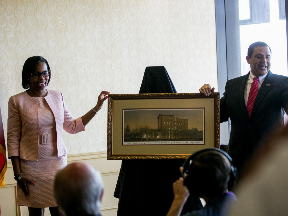 Mayor Ivy Taylor presents Congressman Henry Cuellar with a rendering of the new John H. Wood Jr. Federal Courthouse. Photo by Kathryn Boyd-Batstone.