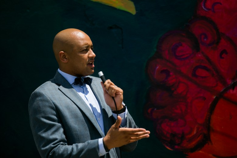 Councilman Alan Warrick (D2) explains the impact of the mural on the community. Photo by Kathryn Boyd-Batstone.