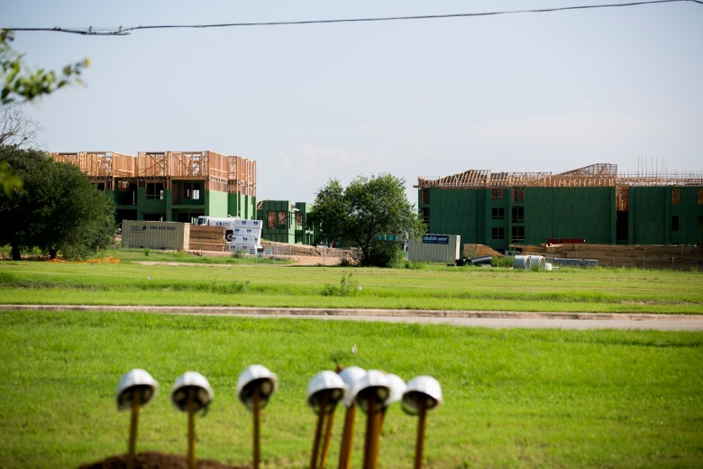 Construction on Brooks City Base apartments can be seen from the soon to be Greenline. Photo by Kathryn Boyd-Batstone.