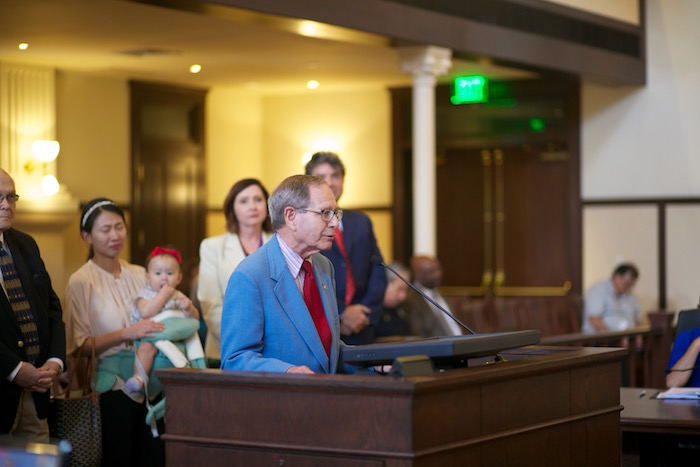"""Bob Buchanan, husband of Sara """"Sally"""" Buchanan, addresses Bexar County Commissioners to thank them for their donation to Confluence ParK in Sally's memory."""