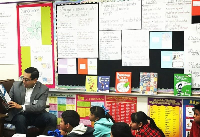 Rep. Diego Bernal (D-123) reads to children at one of the 55 campuses he visited during his education listening tour. Photo courtesy of Diego Bernal.