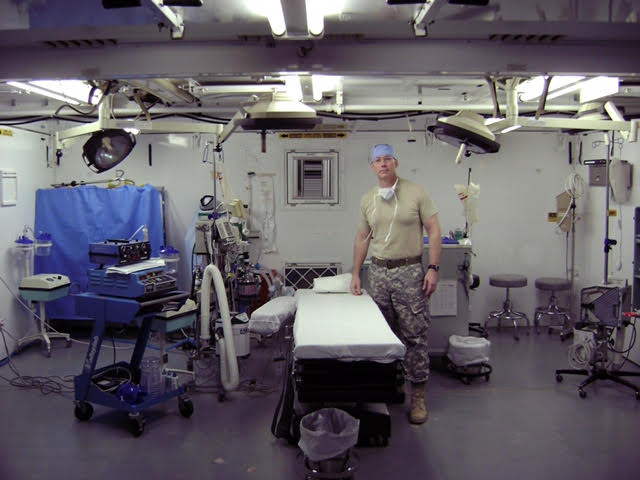 Dr. George Peoples, Jr. stands in an operating room. Photos courtesy of Dr. George Peoples, Jr.