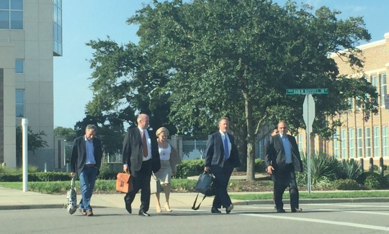 Left to right: Nueces County-Court-at-Law Judge Terry Shamsie, Mikal Watts, his mother State District Judge Sandra Watts of Corpus Christi, criminal defense attorney Mike McCrum, and Texas political consultant Christian Archer leave the courthouse in Gulfport, Miss. Photo by Desi Canela