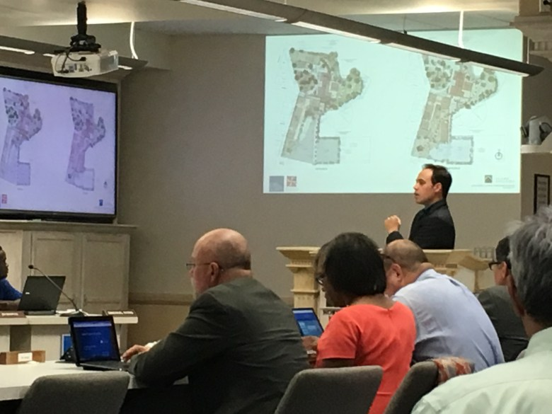 Adam Reed, principle at ford, powell & carson (FPC), explains two revised schemes for Alamo Colleges' new headquarters to the district's board of trustees.