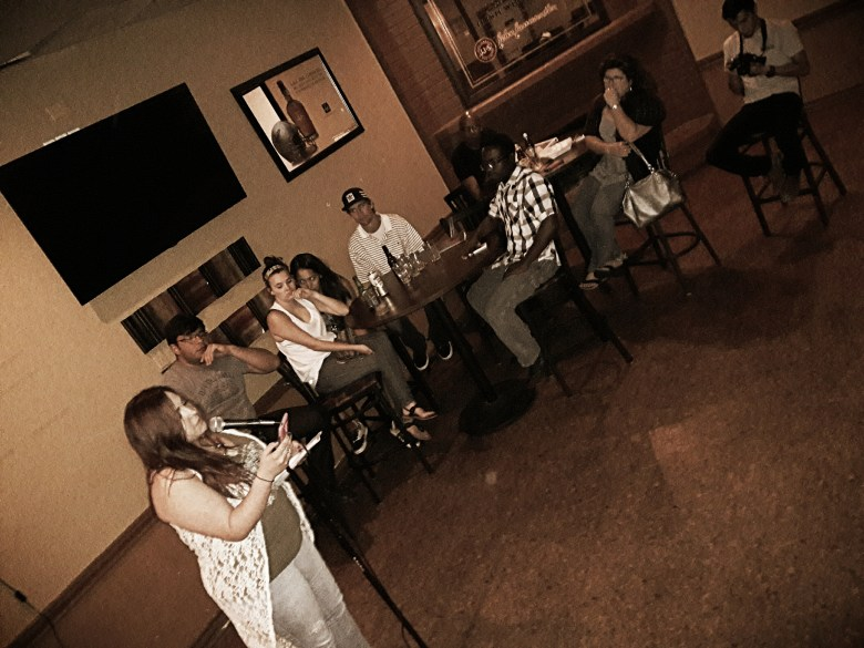 The audience enjoys a poem at The Tavern. Photo courtesy of J. Alejandro