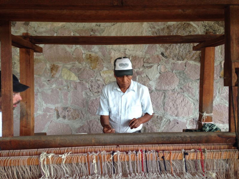 Benito, a third generation weaver in Oaxaca, Mexico, works to preserve the ancient, traditional Zapotecan methods of weaving. Photo by Kimberly Suta.