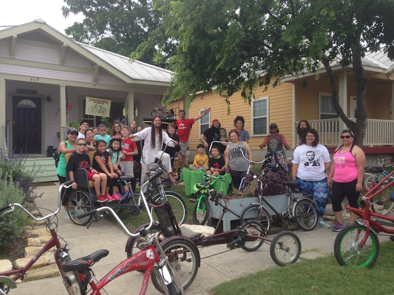 A group of cyclists kicks off a ride at the Carmona's house on Cherry Street. Photo courtesy of Cherry Street Co-Op.