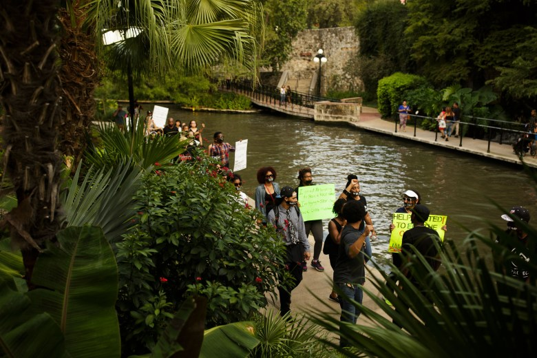 Black Lives Matter activists walk along the San Antonio Riverwalk in protest of the San Antonio Police Officer contract. Photo by Scott Ball.