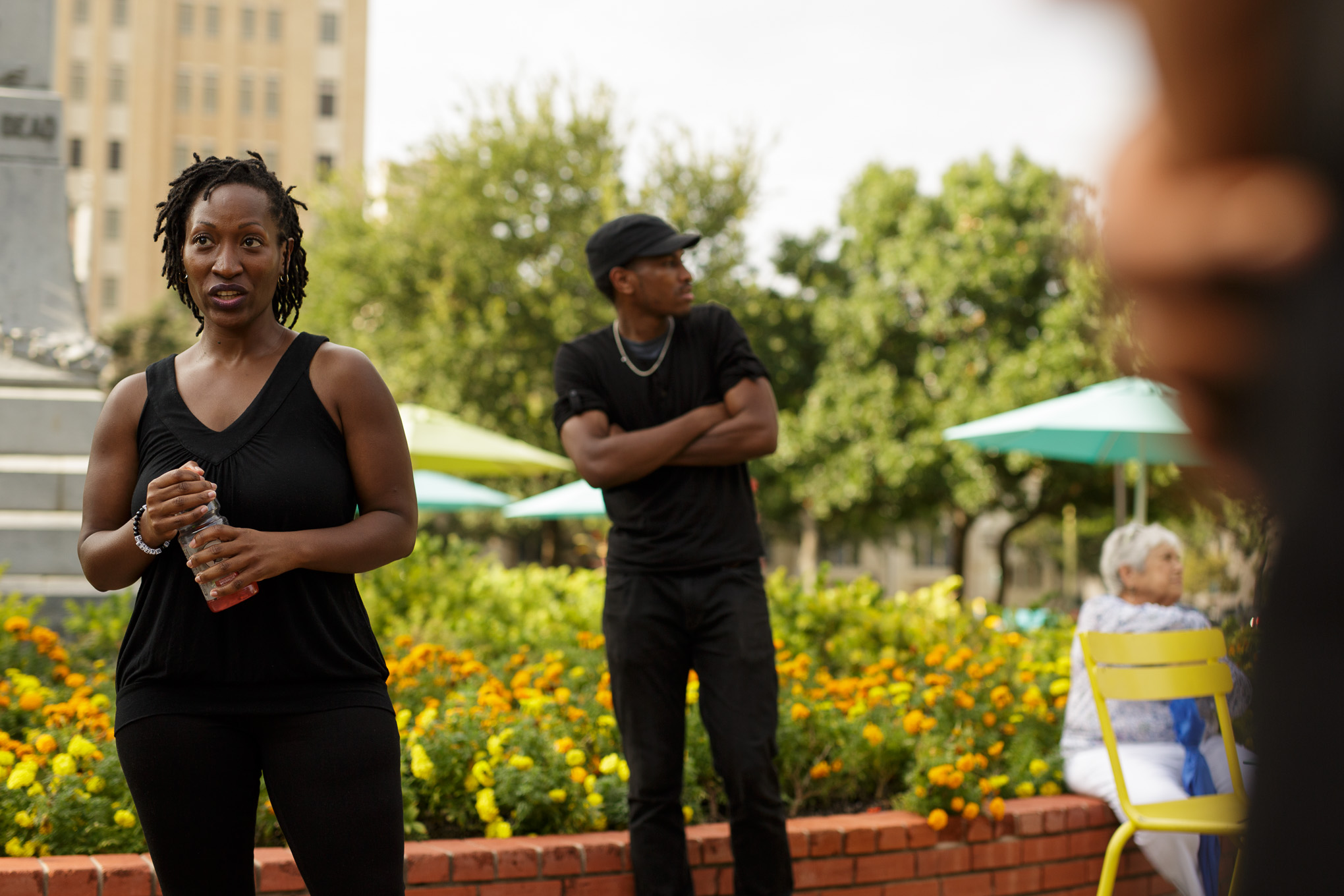 Mary Kate Johnson speaks to local Black Lives Matter activists at Travis Park before the silent protest. Photo by Scott Ball.