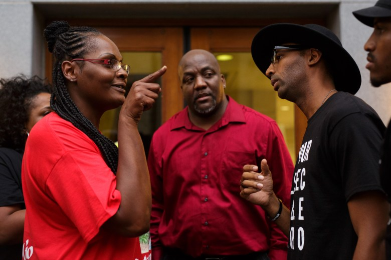 Cheryl Jones (left) speaks with activists and organizers Mike Lowe (right) and Johnathan-David Jones following the the citizens to be heard meeting. Photo by Scott Ball.