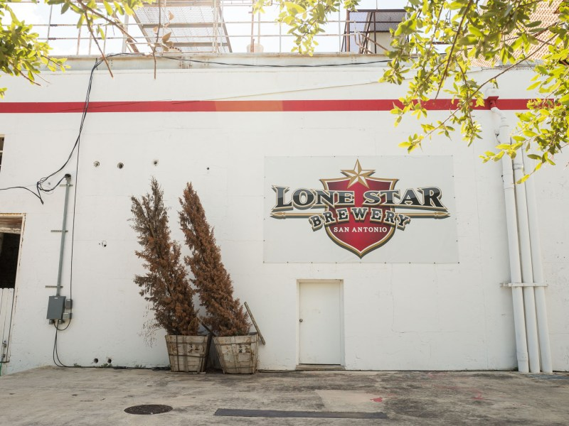 The new Lone Star Brewery logo is pinned along an exterior wall. Photo by Scott Ball.