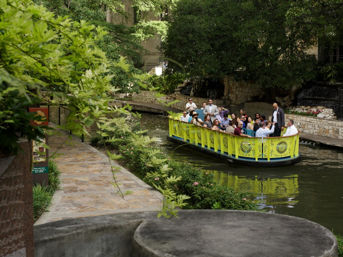 San Antonio community members and elected officials ride on the concept river barge approaching the Arneson River Theater. Photo by Scott Ball.