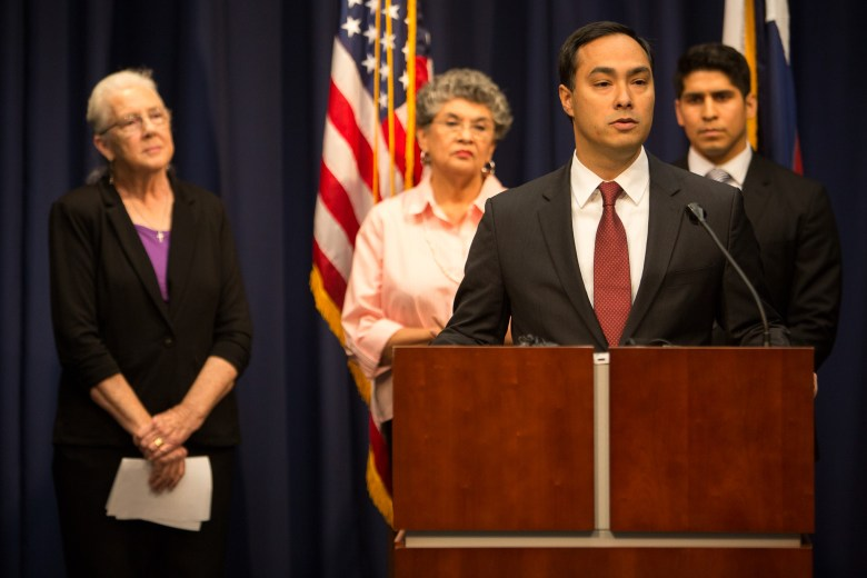 From left: Former City Council members Patti Radle and Maria Berriozábal, look on as U.S. Rep. Joaquín Castro speaks in support of Councilman Rey Saldaña's request for police union contract adjustments.  Photo by Scott Ball.
